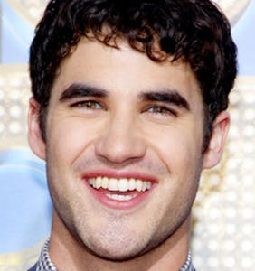 Darren Criss removes his Speedo to show off his stunning sunburn