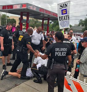 WATCH: Antigay protestor arrested at Pulse memorial… and the crowd goes wild!