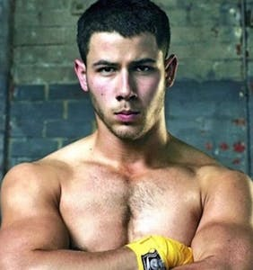 "WATCH: Nick Jonas makes out with another guy in mixed martial arts drama ""Kingdom"""