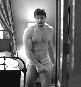 Steve Grand goes walking in a jockstrap through New Orleans