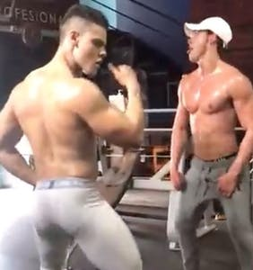 Just some oiled up bros twerking together at the gym, no big deal