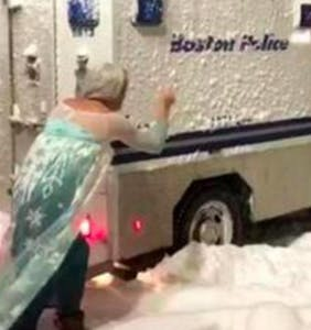Watch this drag queen dressed as Elsa single-handedly free a police van that's stuck in the snow