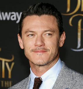 PHOTOS: Is this Luke Evans' boyfriend showing off the goods poolside?
