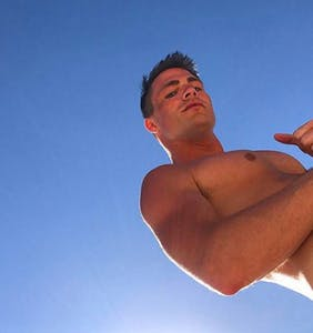 Colton Haynes nearly loses his swim trunks while swinging from a vine like Tarzan