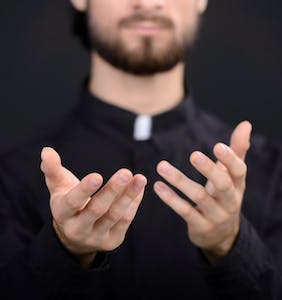 "Priest busted for making ""demonic"" BDSM bisexual threesome video on church altar"