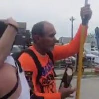 WATCH: 2 guys drive away a Christian Pride protestor by passionately making out