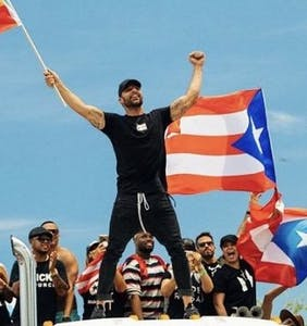 Ricky Martin marches with pride flag against embattled Puerto Rican governor
