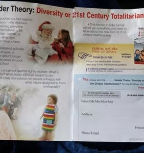 Christian hate group papers town with homophobic pamphlets featuring Santa Claus