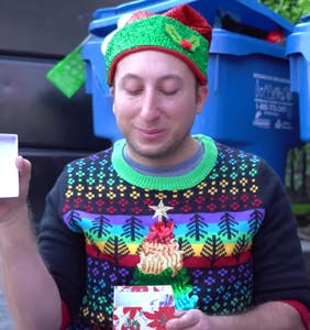 WATCH: Michael Henry and the dumpster queens make the Yuletide extra gay