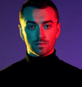 Um, who's this super hot guy Sam Smith was just photographed making out with at a bar?