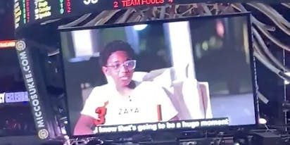 Arena full of basketball fans bursts into applause when Zaya Wade is shown on the jumbotron