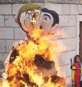 Carnival-goers burn a giant effigy of a gay couple in Croatia