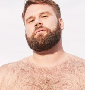 A&F cuts ties with gay plus-size model Michael McCauley over racist social media posts