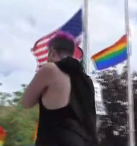 New York protest erupts into celebration after arrest of a man who defaced a pride flag