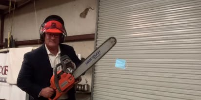 "Antigay lawmaker compares himself to ""Jews in Nazi Germany"" as he chainsaws a mask in half"