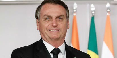 "Brazil's Bolsonaro said masks were ""for fairies"" – before he got COVID-19"