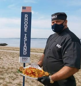 Everyone's talking about the beefcake chef holding a tray of fried calamari during the DNC roll call