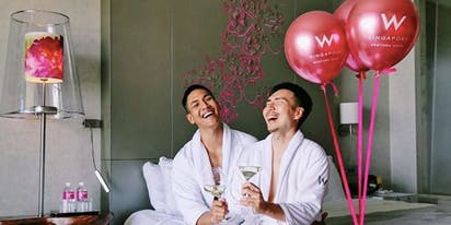 Gay couple's sexy hotel photo shoot prompts praise and criticism in Singapore