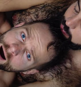 Tom Goss lathers up with a hairy hunk in his latest music video