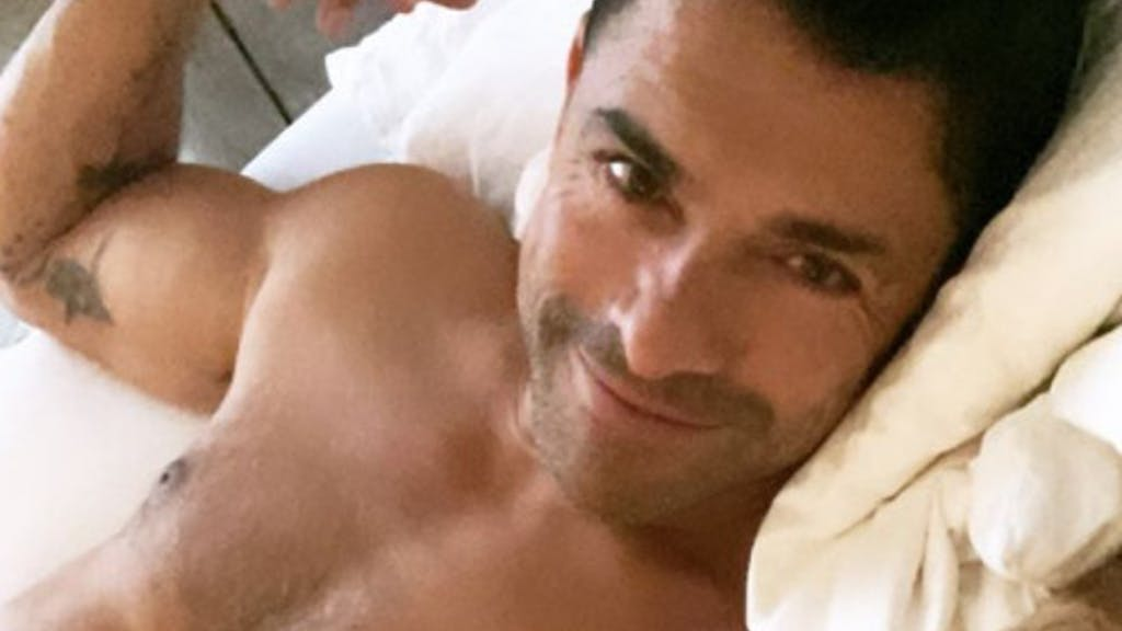 Kelly Ripa just posted a picture of Mark Consuelos in a cop uniform. We need to talk about his baton.