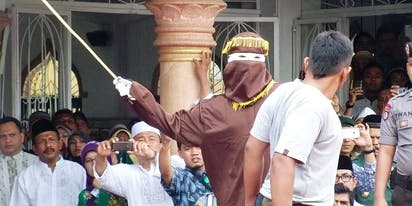 Two men in Indonesia brace for public caning after getting caught having gay sex